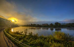 Обои Германия Побережье Реки Рассветы и закаты Лучи света Bremm Природа картинки