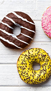 Обои Пончики Сладости Шоколад Сахарная глазурь Доски