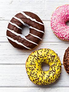 Обои для рабочего стола Пончики Сладости Шоколад Сахарная глазурь Доски Продукты питания