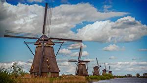 Картинка Нидерланды Реки Небо Мельница Облака Molinos Kinderdijt Природа