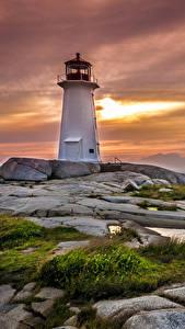 Обои Канада Маяк Рассветы и закаты Берег Камень Небо Траве Peggys Point Lighthouse Природа