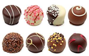 Фотографии Сладости Конфеты Шоколад Белом фоне Еда