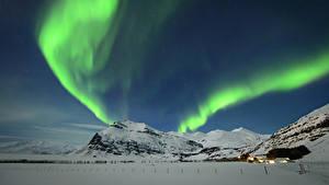 Картинка Исландия Зимние Небо Гора Северное сияние Снегу Природа