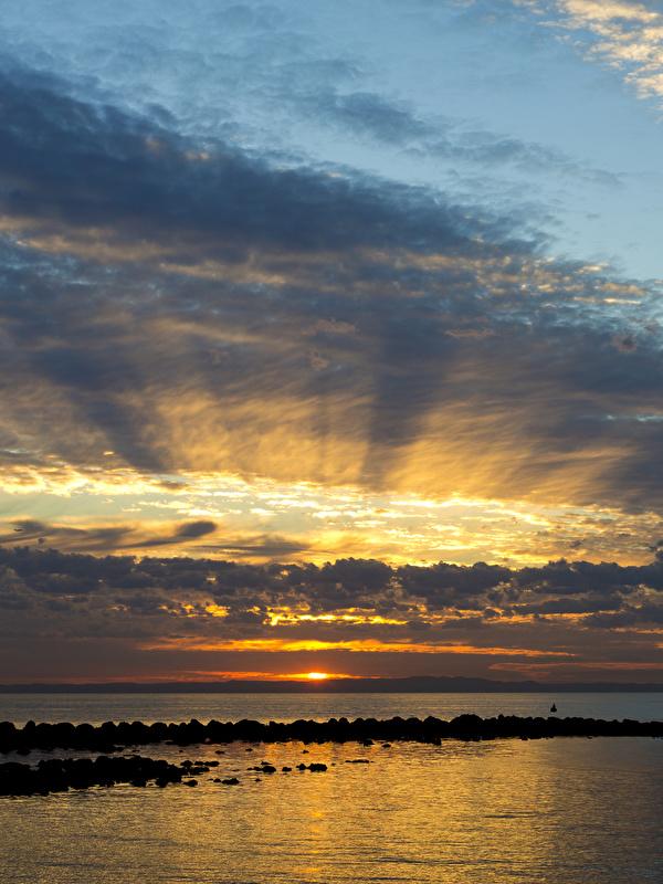 Фото Австралия Queensland Море Природа Небо Рассветы и закаты Облака 600x800