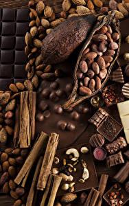 Картинки Сладкая еда Конфеты Шоколад Корица Орехи Шоколадка Еда
