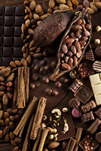 Картинки Сладости Конфеты Шоколад Корица Орехи