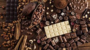 Картинки Сладкая еда Конфеты Шоколад Корица Орехи Шоколадка