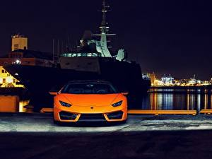 Картинки Lamborghini Спереди Оранжевый Ночь Huracan 2016 LP 580-2 Автомобили