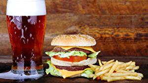 Картинка Пиво Гамбургер Картофель фри Булочки Быстрое питание Стакане Пена Еда
