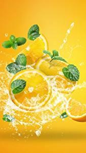 Картинка Апельсин Брызги Капля Цветной фон Продукты питания