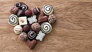 Фото День святого Валентина Сладкая еда Конфеты Шоколад Доски Серце