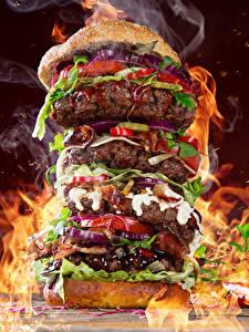 Фотография Быстрое питание Гамбургер Мясные продукты Овощи Пламя