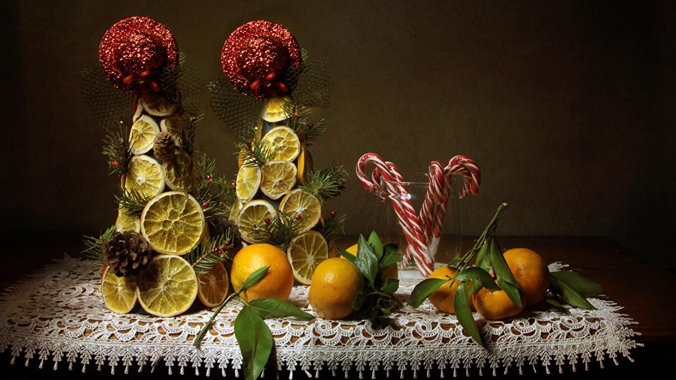 Картинка Мандарины Лимоны Пища Сладости дизайна 1366x768 Еда Продукты питания сладкая еда Дизайн