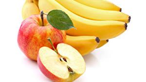 Фотографии Фрукты Бананы Яблоки Вблизи Белом фоне Пища