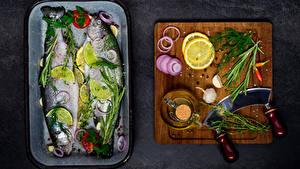 Фотография Рыба Лимоны Чеснок Укроп Специи Разделочная доска