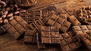 Фотографии Сладости Шоколад Орехи Шоколадная плитка Какао порошок Еда