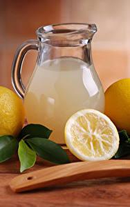 Фото Лимоны Напиток Лимонад Кувшин Ложка Листва