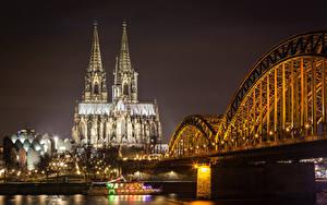 Картинка Кёльн Германия Здания Реки Мост Ночью Уличные фонари город