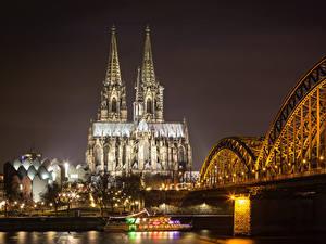 Картинка Кёльн Германия Здания Реки Мосты Ночь Уличные фонари Города