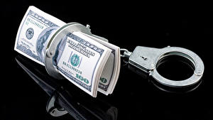 Фотография Деньги Купюры Доллары На черном фоне Наручники