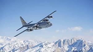 Картинка Аляска Гора Самолеты Снеге Летящий C-130 Hercules Авиация