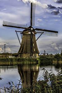 Фото Нидерланды Речка Здания Небо Мельница Kinderdijk Природа