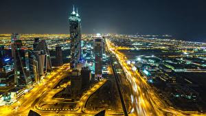 Фото Объединённые Арабские Эмираты Дубай Небоскребы Дороги Мегаполис Ночные
