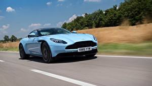 Картинки Aston Martin Едущий Голубая машина