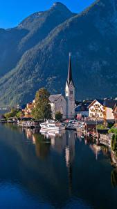 Картинки Австрия Дома Озеро Гора Причалы Халльштатт Побережье город