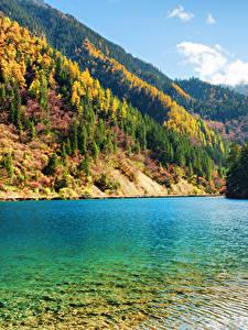 Фото Цзючжайгоу парк Китай Парки Озеро Осенние Горы Леса Пейзаж