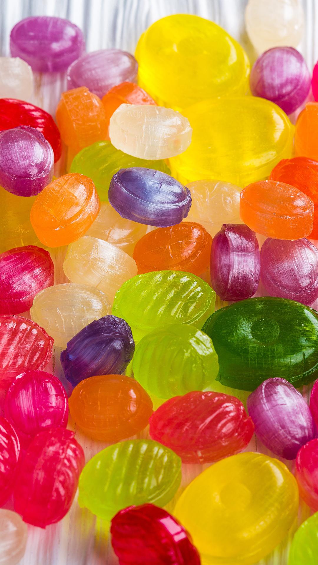 Картинка Разноцветные Конфеты Леденцы Еда Много Сладости 1080x1920 для мобильного телефона Пища Продукты питания сладкая еда