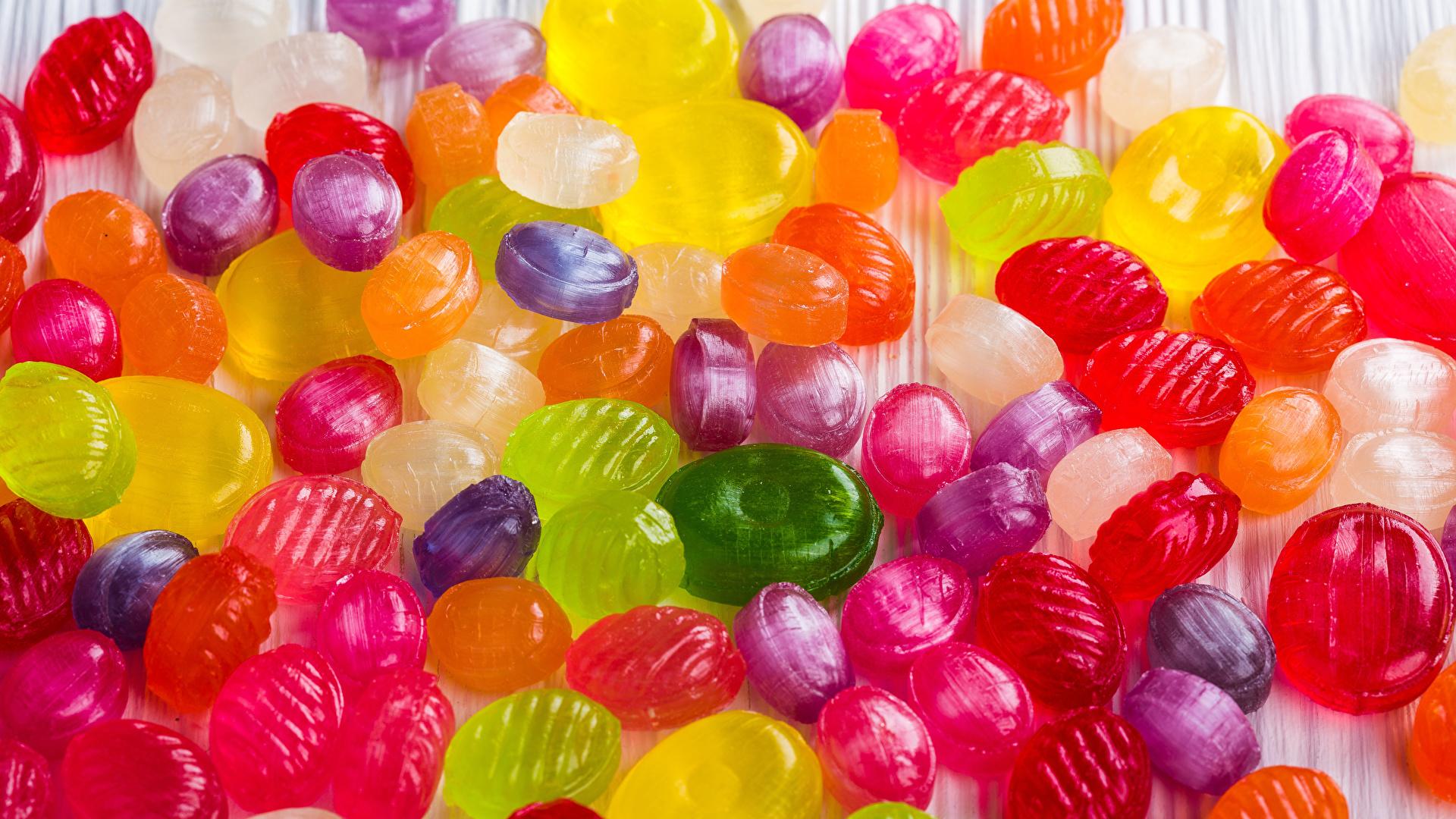 Картинка Разноцветные Конфеты Леденцы Еда Много Сладости 1920x1080 Пища Продукты питания сладкая еда