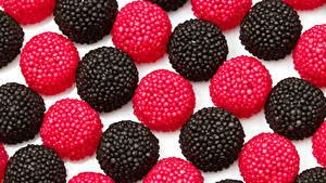 Картинка Сладкая еда Конфеты Мармелад Черных Красный