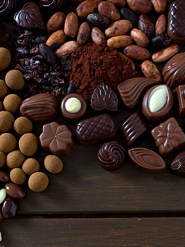 Картинки Шоколад Конфеты Еда Сладости 600x800 для мобильного телефона Пища Продукты питания сладкая еда