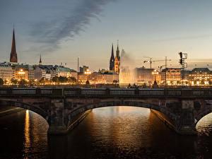 Фотографии Германия Гамбург Дома Реки Мосты Ночь Города