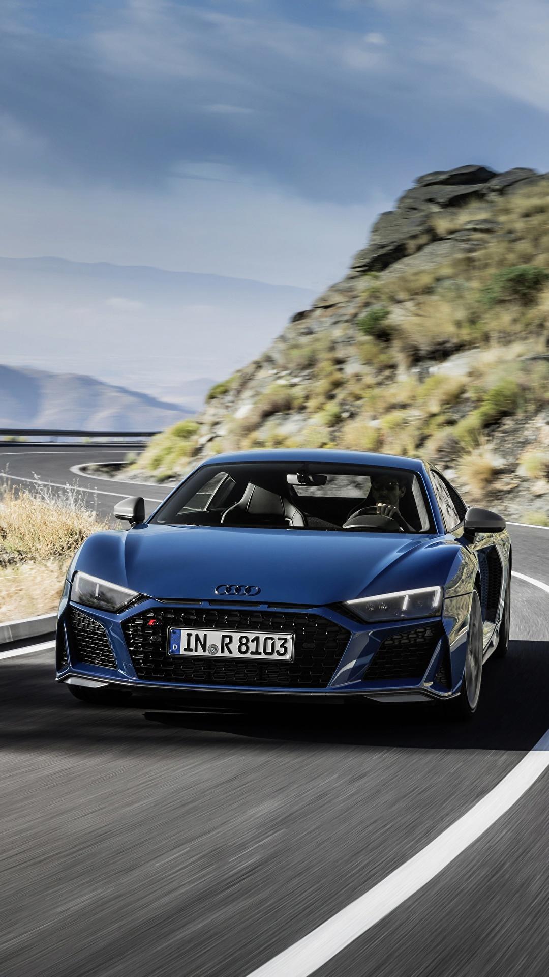 Картинки Audi R8 V10 quattro performance Синий Дороги едущая авто Спереди 1080x1920 для мобильного телефона Ауди синяя синие синих едет едущий скорость Движение машина машины Автомобили автомобиль