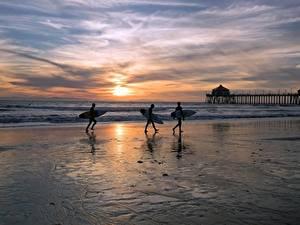 Картинки Штаты Рассветы и закаты Серфинг Океан Пляжи Трое 3 Montana, Huntington Beach Природа