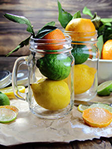 Картинки Цитрусовые Мандарины Лимоны Апельсин Лайм Кружки Доски Банка Еда