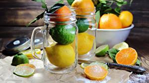 Картинки Цитрусовые Мандарины Лимоны Апельсин Лайм Кружки Доски Банке Еда