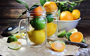Картинки Цитрусовые Мандарины Лимоны Апельсин Лайм Кружка Доски Банка Еда