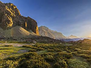 Картинка Чили Рассветы и закаты Горы Альпы Трава Скала Andes mountain