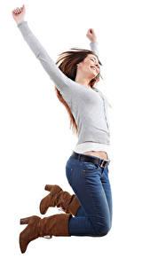 Фотографии Белый фон Шатенка Счастье Прыжок Джинсы Руки Сапоги Девушки