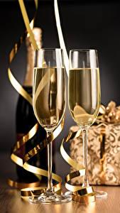 Фотографии Рождество Игристое вино Бокалы Бутылка Еда