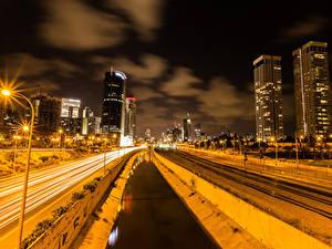 Фотография Израиль Дома Дороги Железные дороги Водный канал Ночью Уличные фонари Tel Aviv