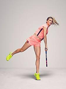 Фото Теннис Удар Ноги Сером фоне Eugenie Bouchard Canadian Спорт Девушки