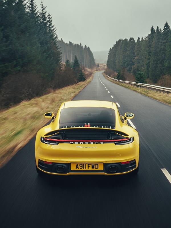 Картинки Porsche 911 Carrera 4S 2019 желтая едет Дороги машины вид сзади 600x800 для мобильного телефона Порше Желтый желтые желтых едущий едущая скорость Движение авто Сзади машина Автомобили автомобиль