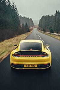 Картинки Порше Дороги Желтый Вид Едущий 911 Carrera 4S 2019 Авто