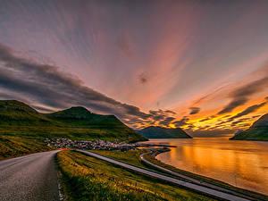 Обои Дания Рассветы и закаты Берег Дороги Горы Leirvík Faroe Islands Природа
