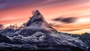 Картинки Рассвет и закат Гора Швейцария Облако Снега Matterhorn, Zermatt Природа