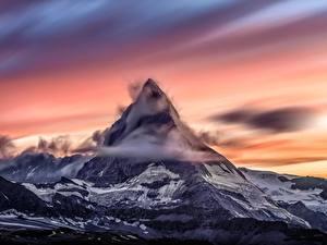 Картинки Рассветы и закаты Горы Швейцария Облака Снег Matterhorn, Zermatt Природа